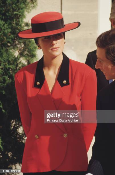 Prince Charles and Diana, Princess of Wales visit Caen in France, September 1987. Diana is wearing a red outfit by Rifat Ozbek and a Philip...