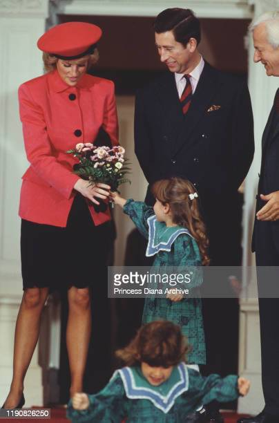 Prince Charles and Diana Princess of Wales visit German President Richard von Weizsäcker in Bonn Germany November 1987 Diana is wearing a suit by...