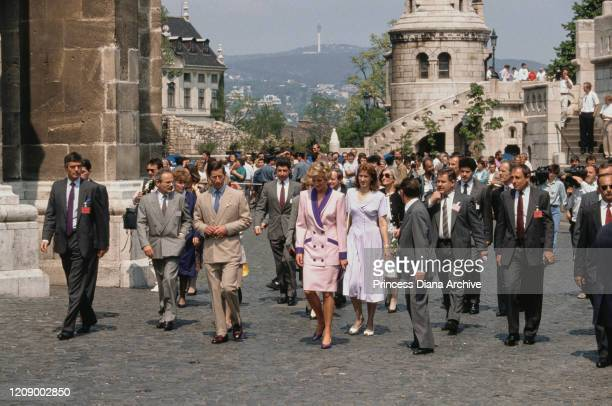 Prince Charles and Diana, Princess of Wales visit the Matthias Church in Budapest, Hungary, May 1990. Diana is wearing a pink and purple suit by...