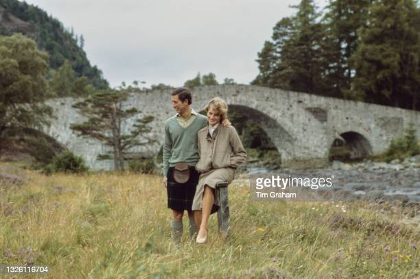 Prince Charles and Diana, Princess of Wales walking by the River Dee at the end of their honeymoon at Balmoral, Scotland, 19th August 1981. Diana is...