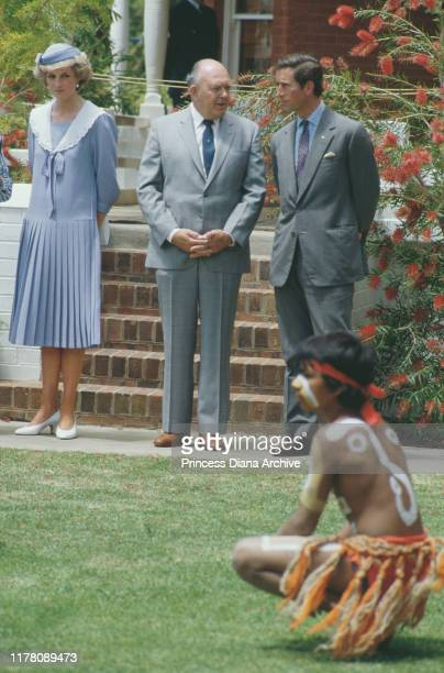Prince Charles and Diana Princess of Wales watch a display of tribal costumes in Mildura Victoria Australia October 1985