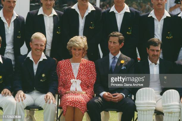 Prince Charles and Diana, Princess of Wales with members of the team at Cardiff Cricket Club in Wales, July 1987.