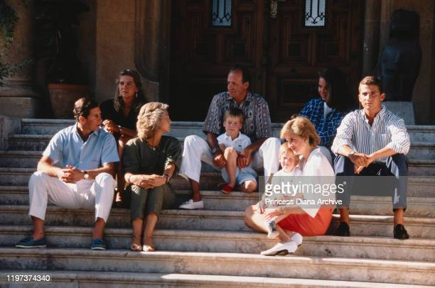 Prince Charles and Diana, Princess of Wales with their sons Prince William and Prince Harry during a holiday with the Spanish royal family at the...