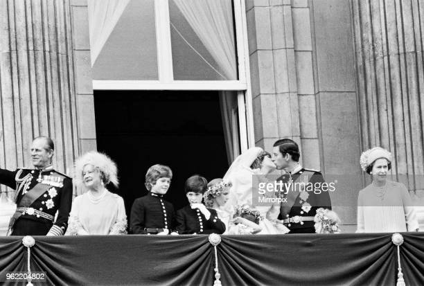 Prince Charles and Diana Spencer wedding, 29th July 1981. The happy couple share a kiss on the balcony at Buckingham Palace, joined by Prince Philip...