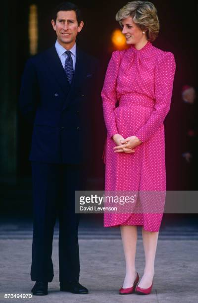 Prince Charles and Diana,Princess of Wales on the steps of St Peter's Basilica in Rome during a Tour of Italy, April 1985. The Princess is wearing a...