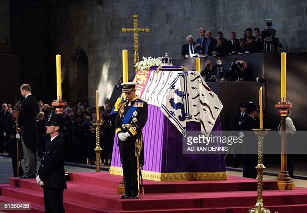 Prince Charles and his brother Edward stand vigil beside the Queen Mother's coffin while it liesinstate at Westminster Hall in London 08 April 2002...