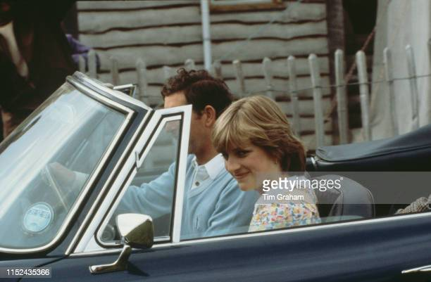 Prince Charles and his fiancé Lady Diana Spencer leaving a polo match at Cowdray Park Polo Club In Gloucestershire in the prince's AstonMartin DB6...