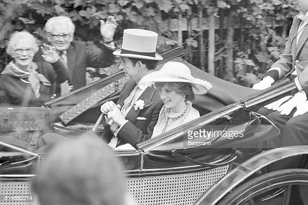 Prince Charles and his fiancee Lady Diana Spencer ride in an open carriage en route to the opening day of the Royal Ascot horse races