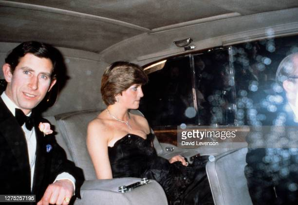 Prince Charles and his new fiancee Lady Diana Spencer arrive at Goldsmith Hall in London for a charity recital in March 1981. Diana wears a low-cut...