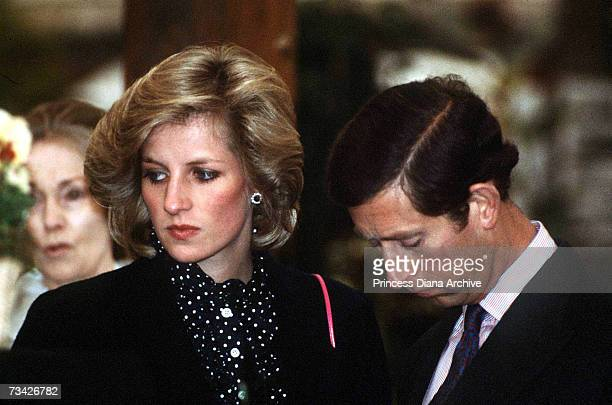Prince Charles and his pregnant wife Princess Diana at the Chelsea Flower Show London May 1984 She is wearing a navy maternity coat by Jan van Velden