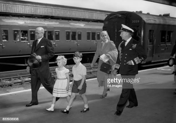 Prince Charles and his sister, Princess Anne, followed by their grandmother, Princess Andrew of Greece also accompanied by Vice-Admiral Conolly, Abel...