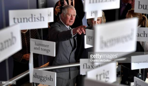 Prince Charles and HRH The Duchess of Cornwall peer through a display of words used by the late Seamus Heaney as he visits the Seamus Heaney Home...