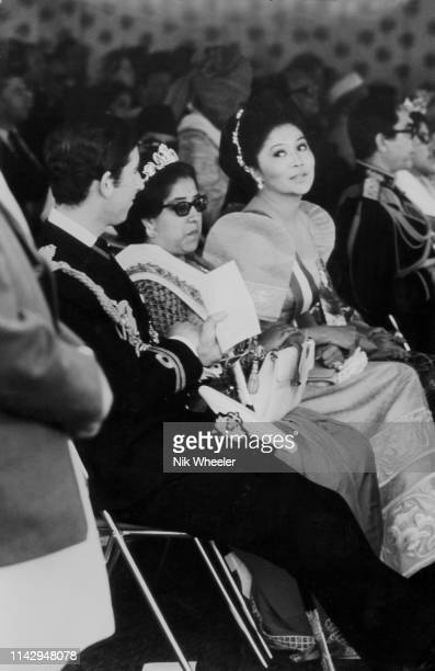 Prince Charles and Imelda Marcos, First lady of the Philippines exchange glances while seated at the ceremony of the Coronation of the King of Nepal...