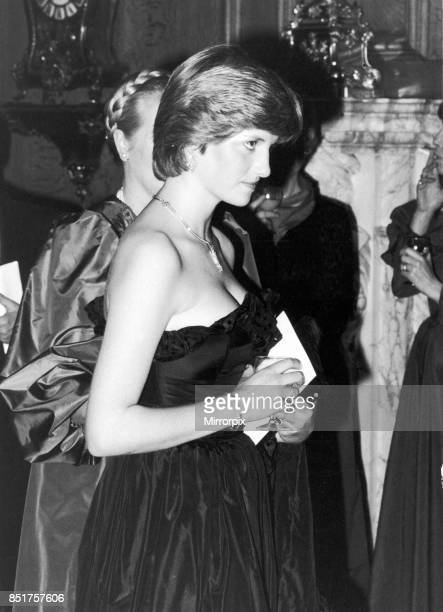 Prince Charles and Lady Diana Spencer attend their first public event together at Goldsmiths Hall, Diana is wearing a Black Taffeta Evening dress...