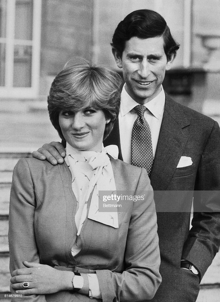 Prince Charles and Lady Diana Spencer pose outside Buckingham Palace following the official announcement of their engagement. Lady Diana, 19, has been a friend of the Royal Family all her life. Prince Charles, 32, has been regarded as one of the world's most eligible bachelors.