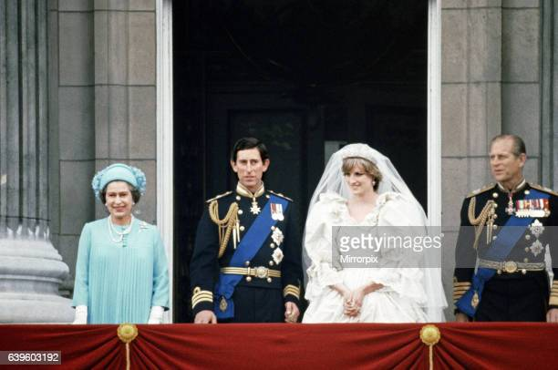 Prince Charles and Lady Diana Spencer with Queen Elizabeth II and Prince Philip on the balcony at Buckingham Palace after their marriage ceremony at...