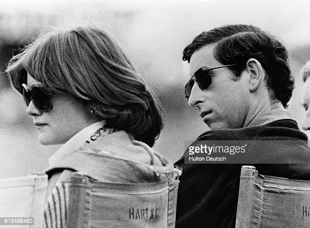 Prince Charles and Lady Sarah Spencer the elder sister of Diana whom he later married watch a polo match at Windsor