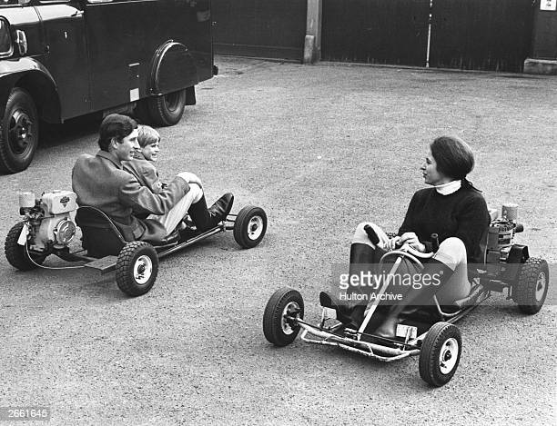 Prince Charles and Prince Andrew racing Princess Anne on motorised gocarts