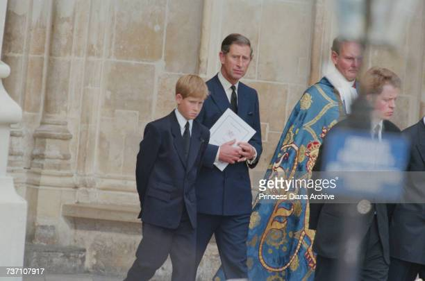 Prince Charles and Prince Harry at Westminster Abbey for the funeral service for Diana Princess of Wales 6th September 1997 On the right is Diana's...