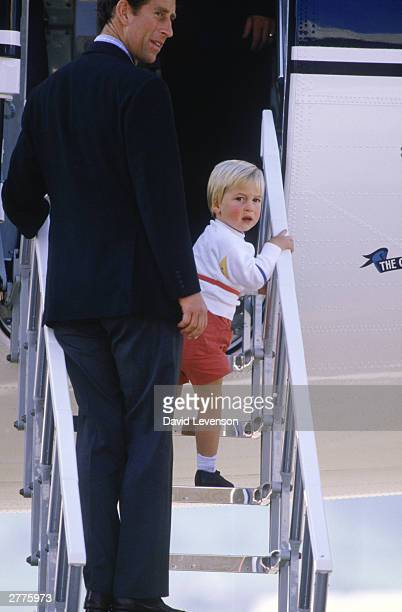 Prince Charles and Prince William board the Queen's Flight plane at Aberdeen Airport in Scotland on September 7 1984 after a holiday in Balmoral for...