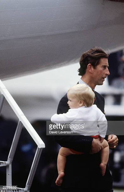 Prince Charles and Prince William disembark the Queen's Flight plane on August 15 1983 at Aberdeen Airport in Scotland after the start of a holiday...