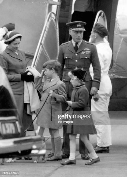 Prince Charles and Princess Anne, each holding a pet corgi on a lead, arrive at Heathrow Airport from Aberdeen. The flight was the first made by the...