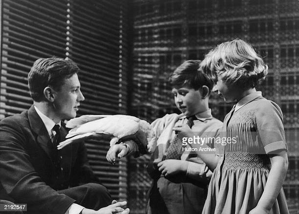 Prince Charles and Princess Anne meet naturalist David Attenborough at Lime Grove Studios on the 4th January 1958 The young royals are introduced to...