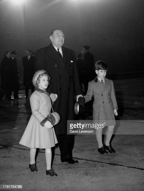 Prince Charles And Princess Anne wait to greet their parents, Queen Elizabeth II and Prince Philip, who had just returned to London Airport, from a...