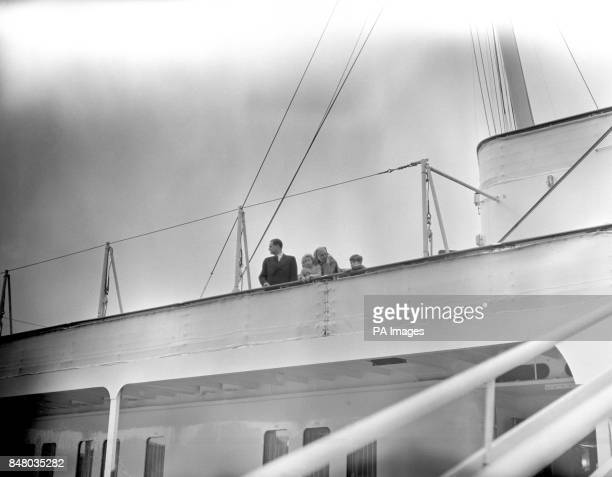 Prince Charles and Princess Anne with their paternal grandmother, Princess Alice of Greece, watch a passing ship from the rail of the Royal Yacht...