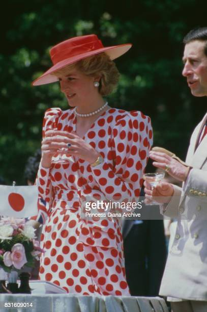 Prince Charles and Princess Diana attend a traditional tea ceremony at Nijo Castle Kyoto Japan 9th May 1986 The princess is wearing a red and white...