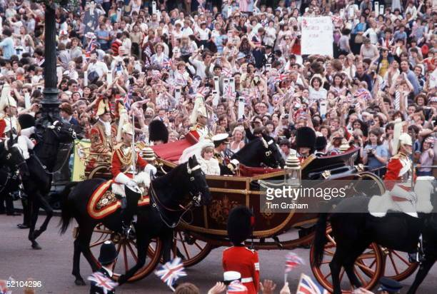 Prince Charles And Princess Diana Being Driven In An Open Carriage Through The Streets Back To Buckingham Palace. Big Crowds Have Gathered To Watch....