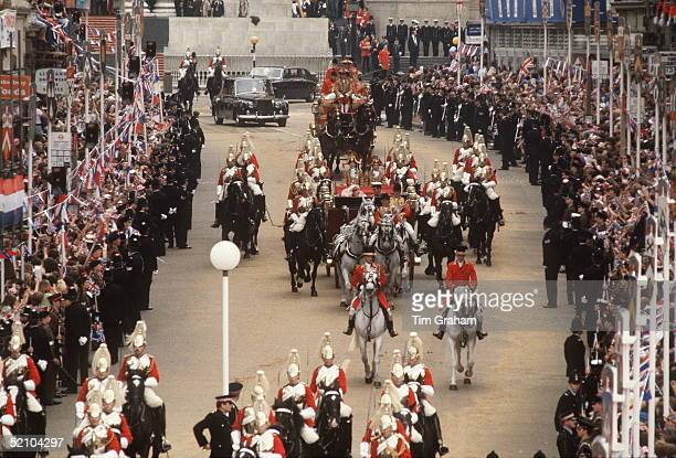 Prince Charles And Princess Diana Being Driven In An Open Carriage From St Paul's Cathedral To Buckingham Palace. They Are Escorted By The Household...