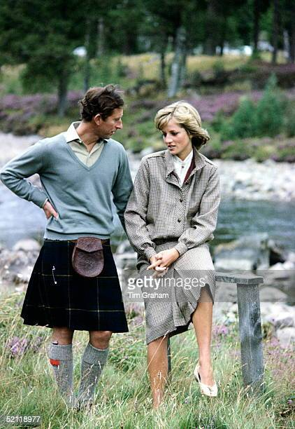 Prince Charles And Princess Diana By The River Dee In The Grounds Of The Balmoral Castle Estate On Their Honeymoon.the Princess Is Wearing A Suit...