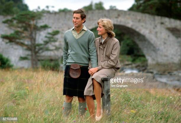 Prince Charles And Princess Diana Holding Hands During A Honeymoon Photocall By The River Dee. The Princess Is Wearing A Suit Designed By Bill...