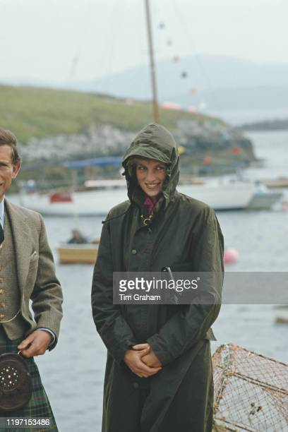 Prince Charles and Princess Diana on the harbourside at Lochmaddy on the island of North Uist in the Outer Hebrides, Scotland, July 1985. The prince...