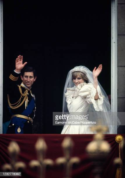 Prince Charles and Princess Diana wave goodbye to the crowds from the balcony of Buckingham Palace after their wedding on July 29, 1981 in London,...