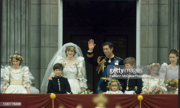 Prince Charles and Princess Diana wave to the crowds on the balcony of Buckingham Palace after their wedding on July 29, 1981 in London, England.