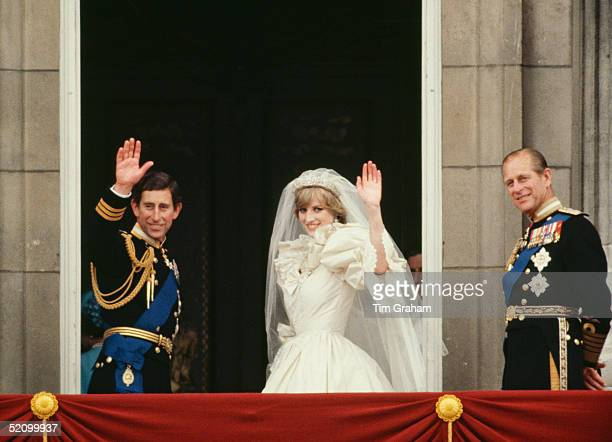 Prince Charles And Princess Diana Waving From The Balcony Of Buckingham Palace. They Are Accompanied By Prince Philip. The Princess Is Wearing A...