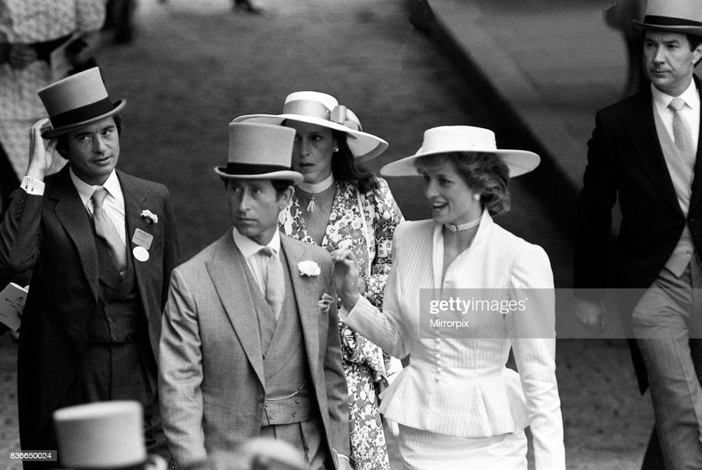 Prince Charles and Princess Diana with Oliver Hoare and his wife Diane behind at Royal Ascot horserace meeting, June 1986.