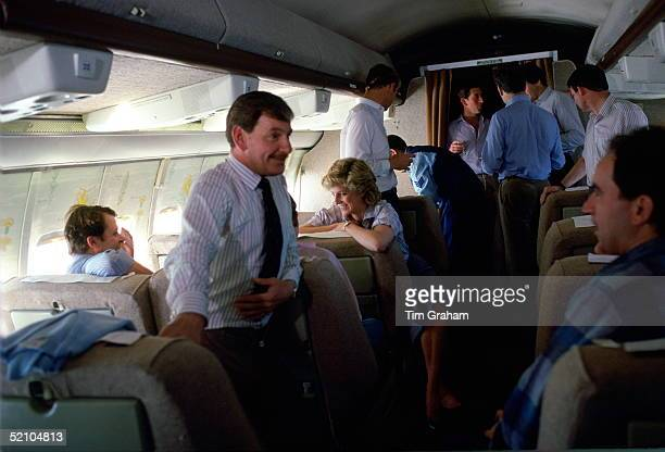 Prince Charles And Princess Diana With Their Staff On Board A Royal Australian Air Force Plane On Its Way From Fiji To Austalia. The Princess Is...
