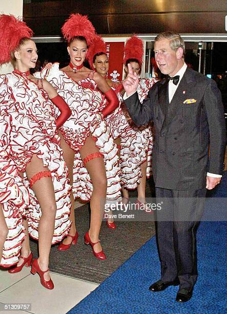 Prince Charles and the Can Can Dancers attend the UK Premiere of Moulin Rouge at The Odeon Leicester Square followed by the party at Tobacco Dock on...
