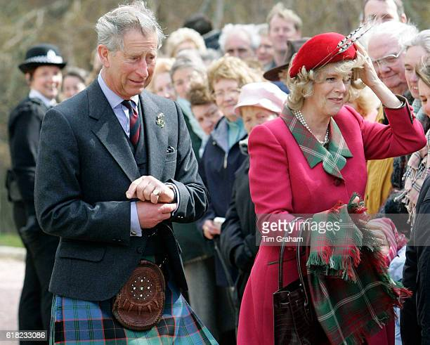 MAY 2005*** Prince Charles and the Duchess of Cornwall in her role as Duchess of Rothesay meeting wellwishers in blustery weather at Crathie Parish...