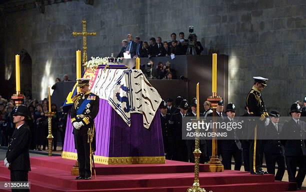 Prince Charles and the Duke of York stand vigil beside the Queen Mother's coffin while it liesinstate at Westminster Hall in London 08 April 2002 The...