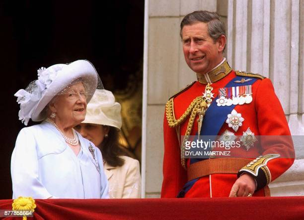 Prince Charles and the Queen Mother talk as they stand on the balcony of Buckingham Palace to watch the Trooping the Colour ceremony Saturday June 12...