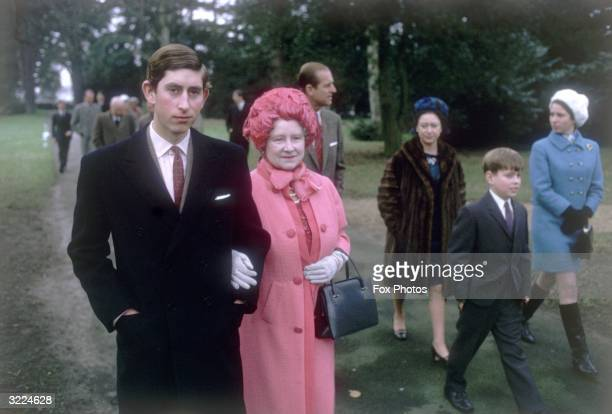 Prince Charles arm in arm with Queen Elizabeth the Queen Mother at Sandringham Prince Philip the Duke of Edinburgh Princess Margaret Princess Anne...