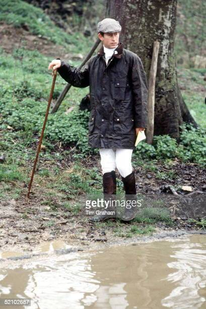 Prince Charles At Cross Country Event Wearing A Green Barbour Style Waxed Jacket And Flat Cap