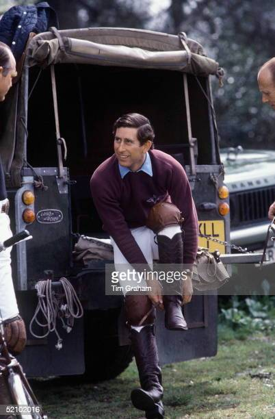 Prince Charles At Smiths Lawn Polo Putting On His Polo Boots While Changing Into His Polo Gear At His Land Rover 4wheel Drive Vehicle Circa 1970s