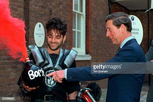 Prince Charles At St James's Palace To Celebrate The 2500o Th Person To Benefit From The Prince's Youth Business Trust He Is Pointing At An Imitation...