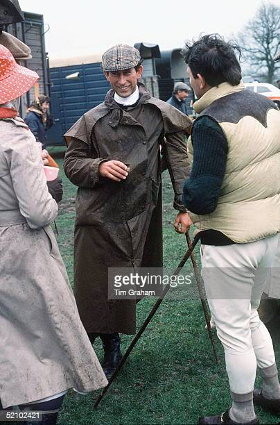 Prince Charles At The Fernie Hunt Cross Country Team Event Wearing Barbour Style /dryasabone Style Raincoat Flat Cap And Walking Stick And Chatting...