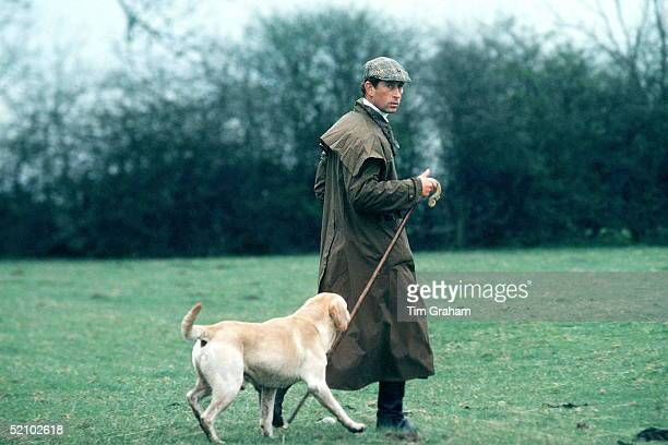 Prince Charles At The Fernie Hunt Cross Country Team Event Wearing Barbour Style / Dryasabone Style Raincoat Flat Cap And Walking Stick And With His...